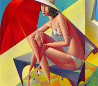 woman sitting on a beach under a red umbrella