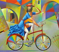 woman in blue dress on bicycle