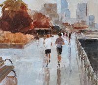 people jogging down a wet street