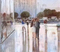 people walking down a wet street in a city