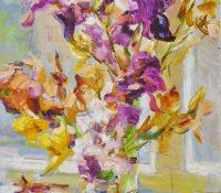 purple and orange irises in a vase