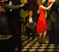 couple dancing, woman in red, lady in red, man playing accordion