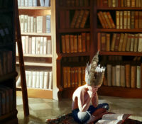 boy reading in a library