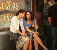 women sitting talking drinking smoking outside