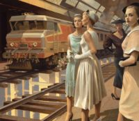 women standing at a train station