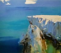 white snowy cliff blue sky