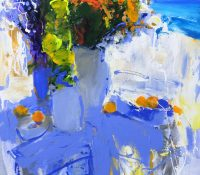 flowers in vase by the sea