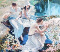 women in a garden by a lake