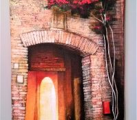 old Italian courtyard with red bougainvillea