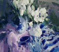 white tulip and striped cloth stillife