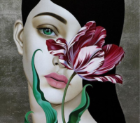 portrait of woman with red tulip