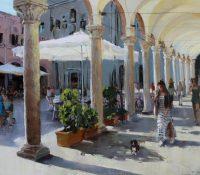 woman walking in Italian sunlit piazza