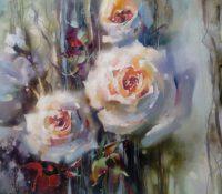 three peach colored roses