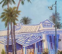 blue and white striped restaurant and palms