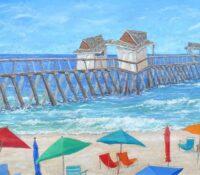 umbrellas on the beach and pier