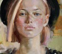 girl in hat polka dot shirt