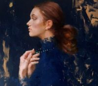 profile of woman in blue